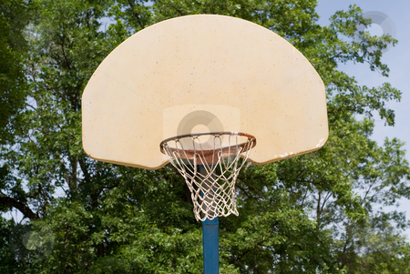 Basketball stock photo, Basketball net and backboard shot against some trees by Richard Nelson