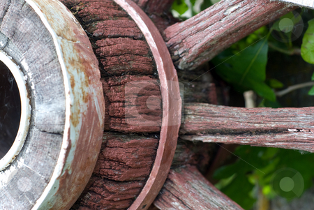 Wagon Wheel stock photo, Closeup view of a wooden wagon wheel by Richard Nelson