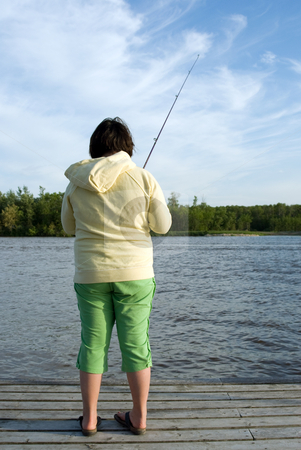 Child Fishing stock photo, A preteen fishing outside in a small lake on a summer day by Richard Nelson