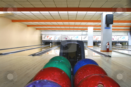 Bowling alley stock photo, Bowling balls with bowling lanes as background by Jonas Marcos San Luis