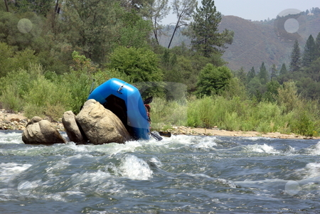 Riding The Rocks stock photo, River rafters miss the channel and get hung up on boulders rafting down the American river by Lynn Bendickson