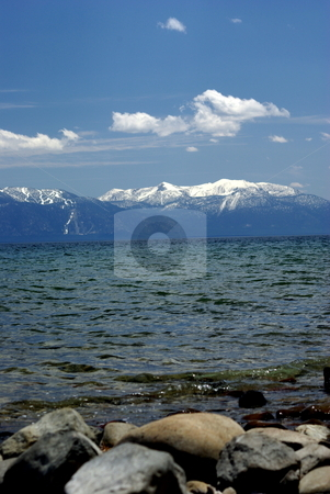 Lake Tahoe And Snow Covered Mountains stock photo, A view across Lake Tahoe looking East across towards Nevada by Lynn Bendickson