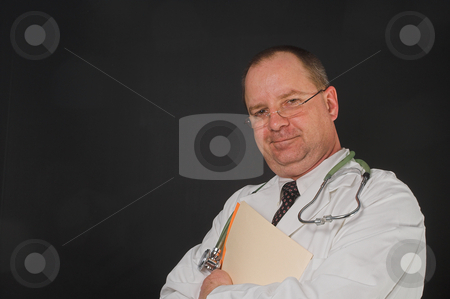 Medical Doctor stock photo, A medical doctor holding a patient's chart. by Robert Byron