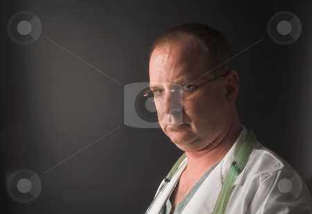 Doctor stock photo, A medical doctor waiting on his next patient. by Robert Byron