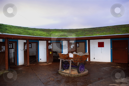 Farm Stables stock photo, A photograph of stables with an ecologically sound 'green roof' by Philippa Willitts