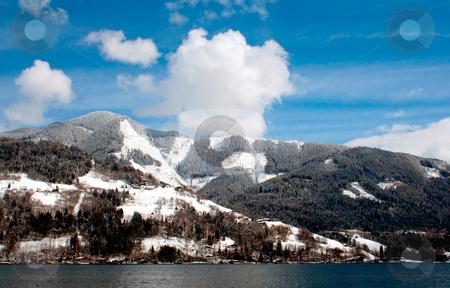 Tranquil Alpine Scene stock photo, Tranquil Alpine lake scenery in Switzerland. by Martin Crowdy