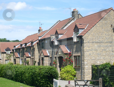 Modern English Housing estate stock photo, Modern English house end of terrace by village green. by Martin Crowdy
