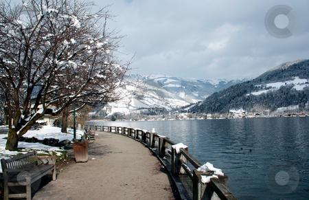 Tranquil Alpine lake stock photo, Tranquil Alpine lake in Switzerland. by Martin Crowdy