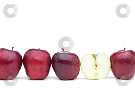 Red delicious apples with an individual eaten green apple stock photo, Red apples lined up on a white background with a single eaten green apple by Vince Clements