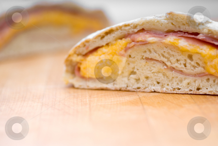 Shallow focus ham and cheese loaf stock photo, Shallow focus ham and cheese loaf on a wooden cutting board by Vince Clements