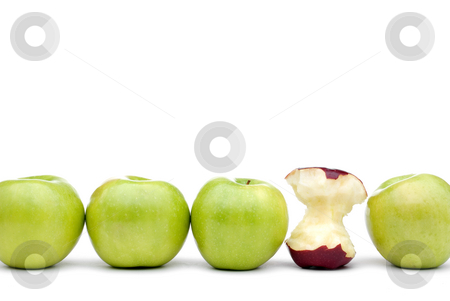 Green apples with an individual eaten red apple stock photo, Green apples lined up on a white background with a single eaten red apple by Vince Clements