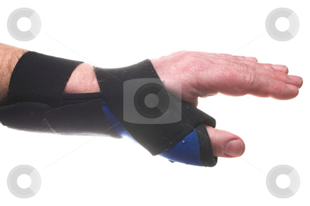 Wrist Brace stock photo, A stiff fabric brace for broken or sprained wrists. by Robert Byron