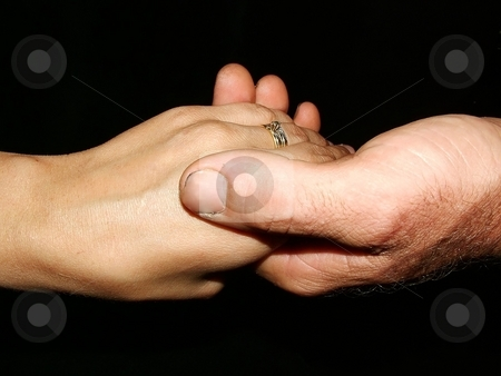 Couples hands stock photo, A couples hands isolated on black by Michelle Bergkamp