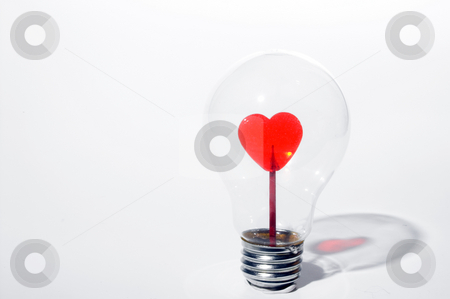 Light Hearted stock photo, A heart inside of a light bulb. by Robert Byron