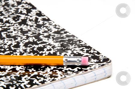 Pencil and Notebook stock photo, A number 2 pencil and a composition book. by Robert Byron