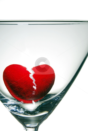Drowning a Broken Heart stock photo, A broken heart drowning in a martini glass. by Robert Byron