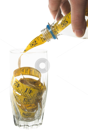 Weight Loss Concept stock photo, Weight Loss Concept - A tailor's tape pouring into a drinking glass. by Robert Byron
