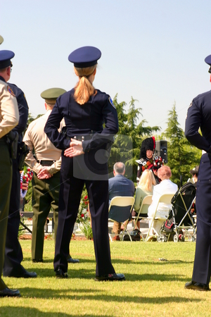 Police Girl stock photo, Peace Officer standing at parade rest. by Henrik Lehnerer