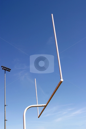 Football Goal stock photo, American football goal with the sky as a background. by Henrik Lehnerer
