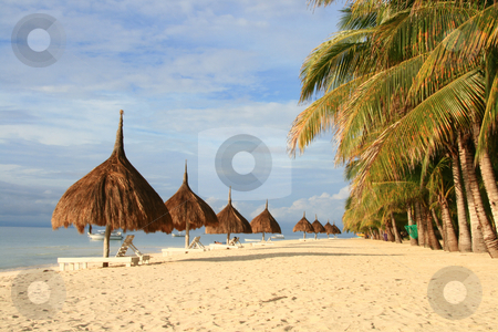 Beach resort 1 stock photo, Rows of nipa hut shade along the beach by Jonas Marcos San Luis