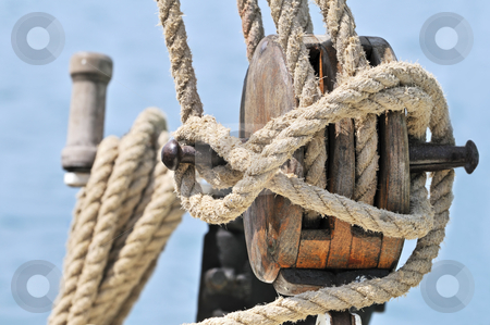 Old sailing equipment stock photo, Close-up of a wooden block, winch and  rigging of an old sailboat by Massimiliano Leban