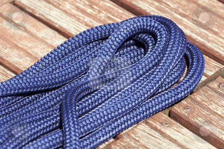 Nautical rope stock photo, Close-up of a blue rope on a wooden jetty by Massimiliano Leban