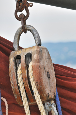 Old sailing equipment stock photo, Close-up of an old wooden block with rope by Massimiliano Leban
