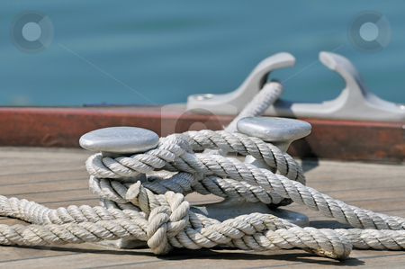 Moored boat stock photo, Close-up of rope tied up on a bitt by Massimiliano Leban