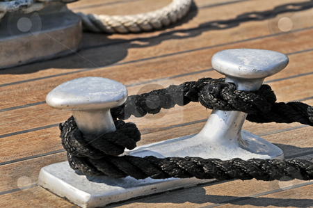 Moored boat stock photo, Close-up of a bitt on a wooden deck by Massimiliano Leban