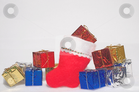 Christmas Presents in a Santa Stocking in the Snow stock photo,  by Robert Byron