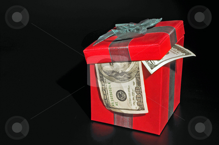 Christmas Present stock photo, A Christmas box with 100 dollar bills. by Robert Byron