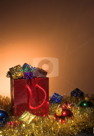 Christmas Presents stock photo, Christmas presents in a festive shopping bag. by Robert Byron