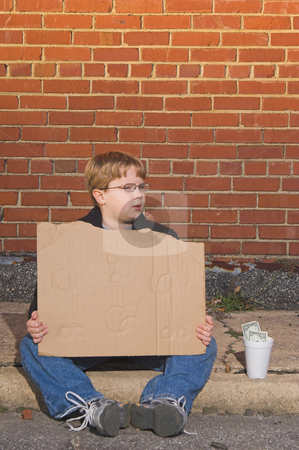 Homeless Boy stock photo, A homeless boy with a blank cardboard sign. by Robert Byron