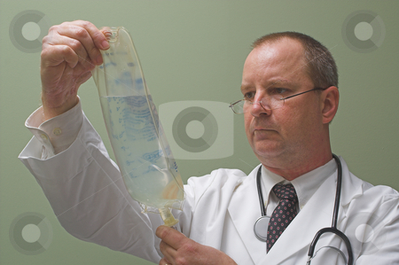 Doctor with an IV stock photo, A medical doctor preparing an IV solution. by Robert Byron