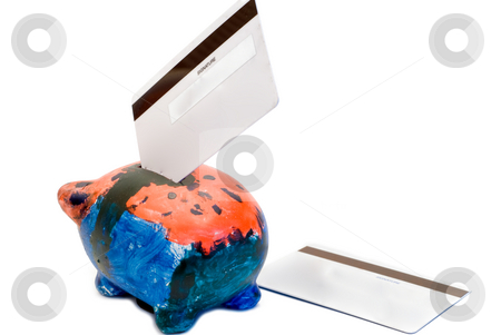 Piggy Bank stock photo, A colorful piggy bank with two bank cards, isolated on a white background by Richard Nelson