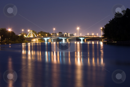 City Bridge at Night stock photo, A view of a city bridge with reflections on the river by Richard Nelson