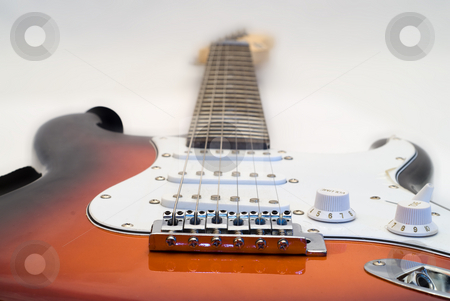 Electric Guitar stock photo, Low angle view of an electric guitar shot on white by Richard Nelson