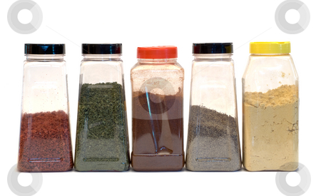 Line of Spices stock photo, A row of spices isolated on a white background by Richard Nelson