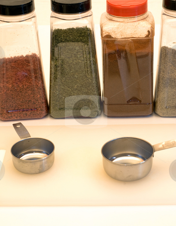 Kitchen Tools stock photo, Assortment of spices alond with measuring tools and a cutting board by Richard Nelson