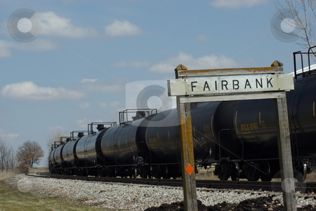 Tank Cars Waiting to be Filled stock photo, Tanker cars on a rail siding by Fairbank, Iowa wait to be filled with ethanol made from corn at a ethanol plant.  There are 25 biofuels plants in Iowa already producing ethanol from corn.  Iowa is the leading corn producer in the nation and also number one in ethanol (biofuel) production (photo 04/02/2008). by Dennis Thomsen