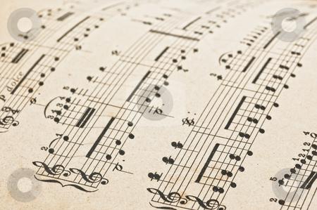 Music score stock photo, Antique music score, close up studio shot. by Pablo Caridad