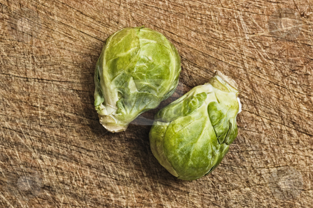 Brussels sprouts stock photo, Brussels sprouts, close up, on wooden table,  studio shot. by Pablo Caridad