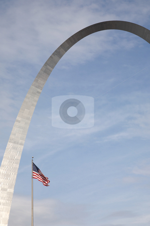 St. Louis arch and US Flag stock photo, An interesting view of the St. Louis Arch - Gateway to the West - the Jefferson National Expansion Memorial (U.S. National Park Service) by Mitch Aunger