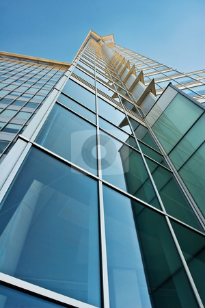 Blue and Green Glass Office Tower stock photo, Modern steel and glass skyscraper that could be from any city by Mark S