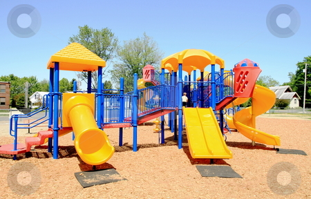 Colorful Playground stock photo, Bright colorful playground at a school yard by Jack Schiffer