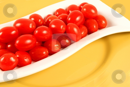 Tomatoes stock photo, Cherry tomatoes in white rectangular plate by Jack Schiffer