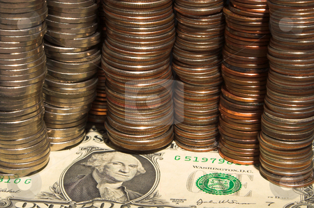 Money stock photo, Assorted coins on a one dollar bill. by Robert Byron
