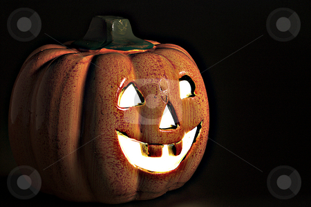 Jack-O-Lantern stock photo, A lighted jack-o-lantern on a dark halloween night. by Robert Byron