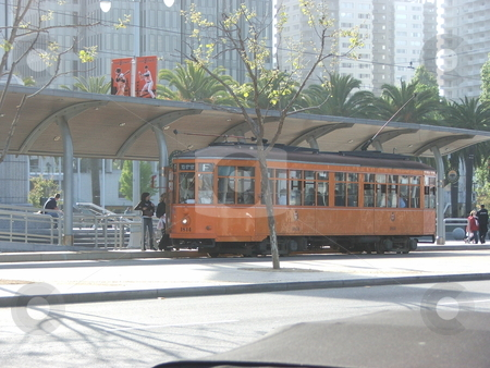 San Francisco trolley stock photo, With land at a premium in San Francisco, parking is hard to find in the tourist oriented waterfront streets of Market and Embarcadero.  Public transport via quaint city streetcars, trolley, and cable car saves both time, money and parking hassels for residents and tourists. by Dennis Thomsen