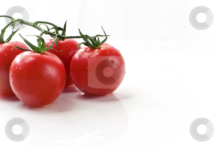 Red Ripe Vine Cherry Tomatoes On White Plate stock photo, Organic cherry tomatoes by Mark S